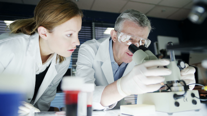 scientists-use-microscopes-in-a-laboratory_71fqsfw7k__F0000.png