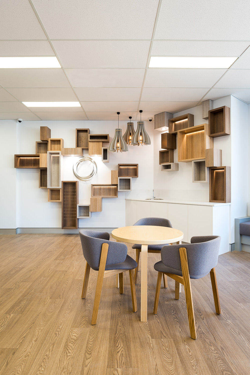 """Your lights are always a refreshing addition to our waiting spaces and are often praised by patients. The pendant lights with their timber elements and selected globe temperature fit beautifully with the modular wall."" - — Tom P"