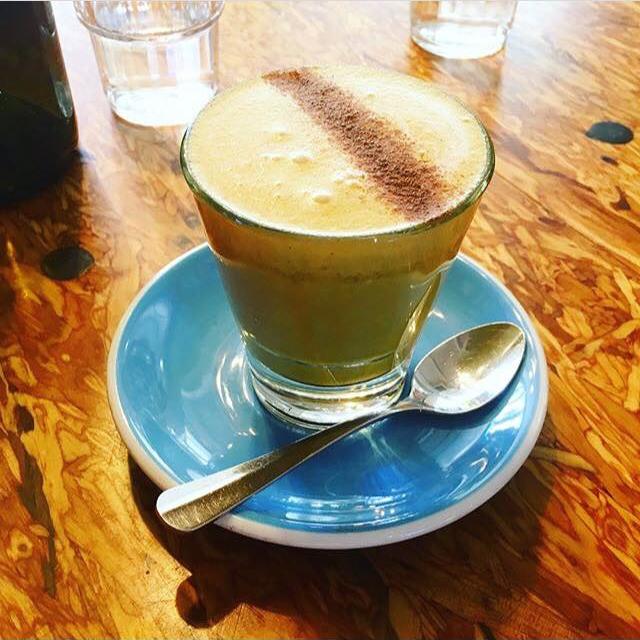 golden latte at a cafe.png