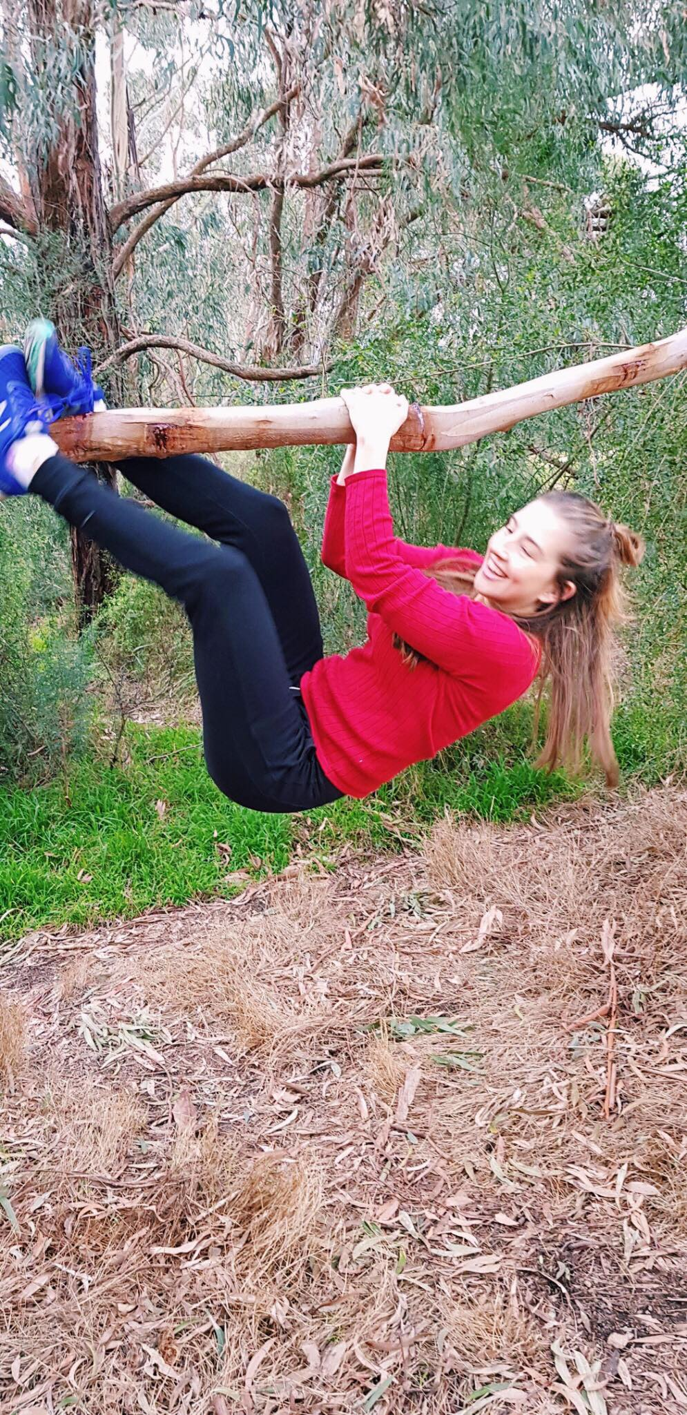 girl hanging off tree branch.jpg