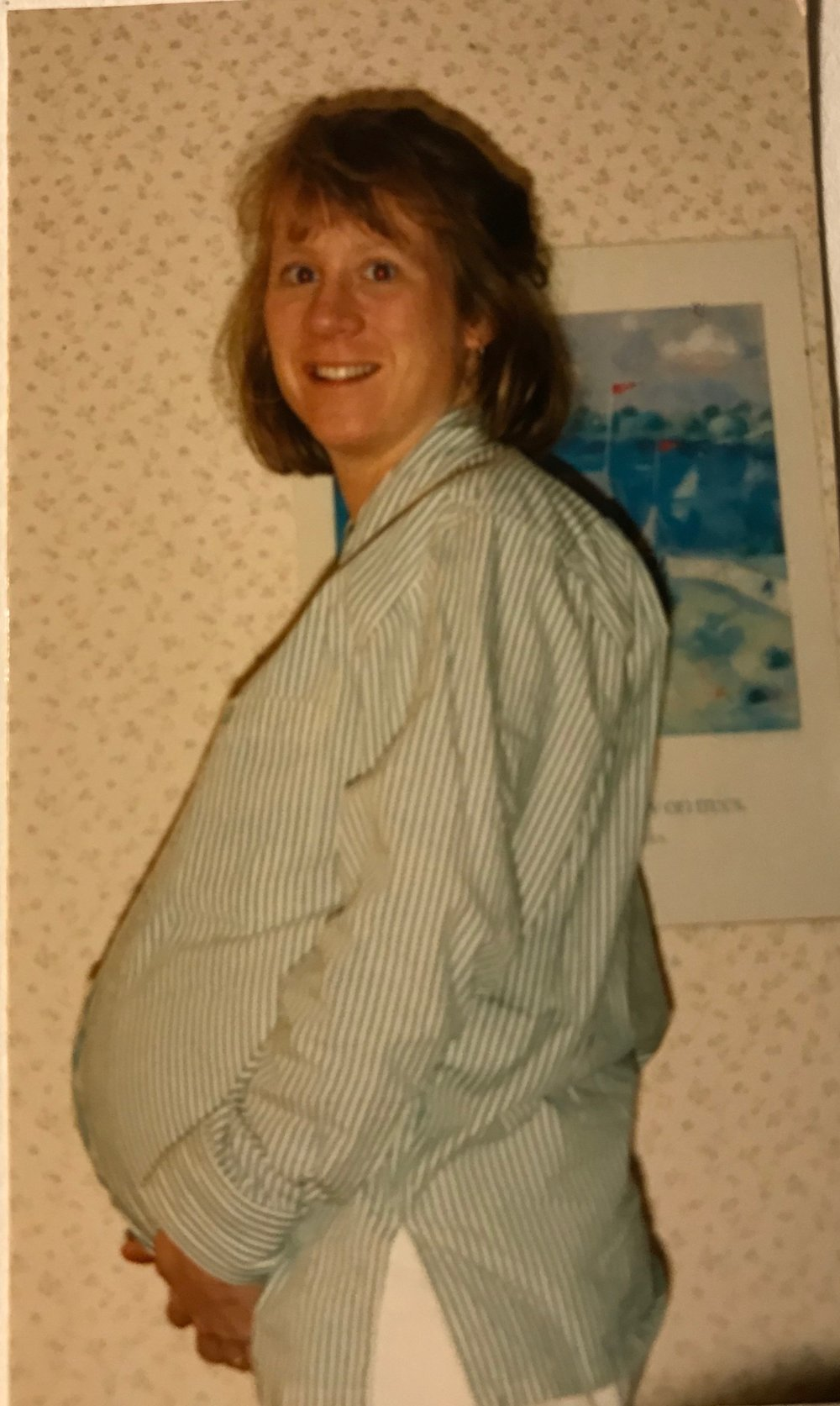 My beautiful mama, pregnant with me!