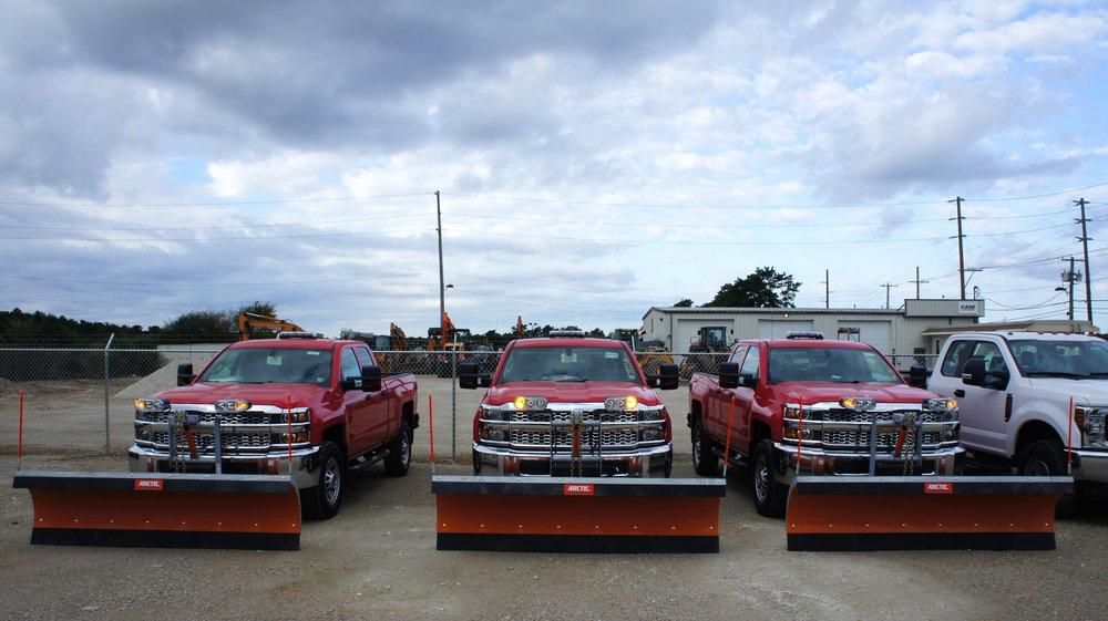Three plowstrucks, ready for service