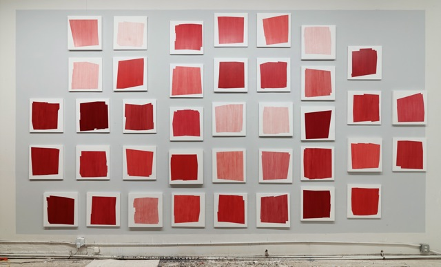 "Installation of ""A Story of Red"" (39 paintings, each 18x18), 2014"