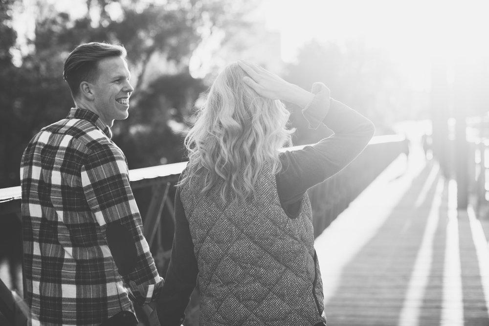 couple-on-bridge-walking-to-sun.jpg