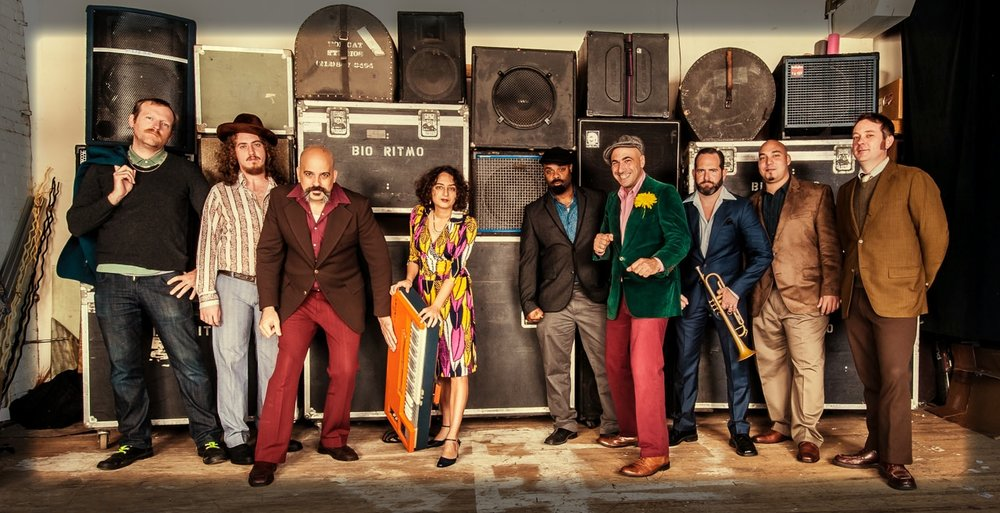 "Left to Right: Edward Prendergast, Bass / John Lilley, Tenor Sax, / Rei Alvarez, Lead Vocals, Composer /  Marlysse Simmons, Keyboards, Composer / Hector ""Coco"" Barez, Congas / Giustino Riccio, Timbale, Coros, Composer / Bob Miller, Trumpet, Synth, Coros / Marc Roman, Bongo /  Tobias Whitaker, Trombone, Composer. Not pictured Will Roman, Trumpet. Photo by Chris Smith"