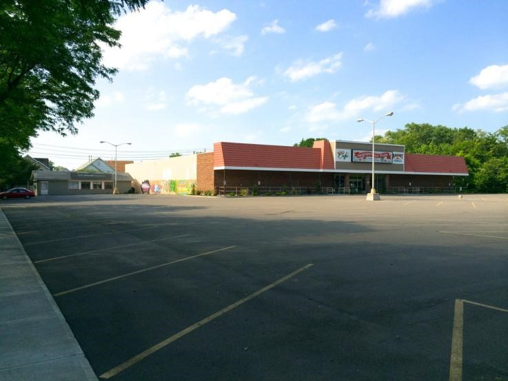 Project site before with abandoned store and parking lot