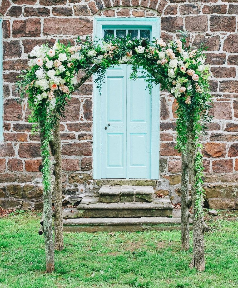 Summer floral wedding arbor