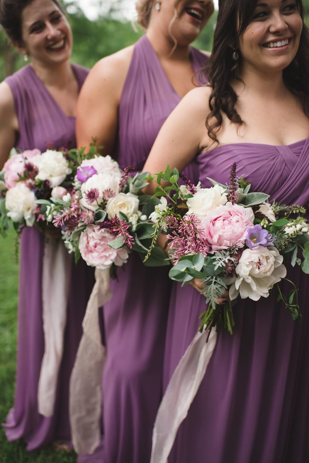 violet bridesmaids bouquets