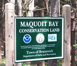 Maquoit Bay Conservation Land  is A 124 acre park with frontage on Maquoit Bay, this wooded conservation land offers a 6/10 mile trail to a rocky outcrop overlooking the bay.  the park's main entreance is located on Bunganuc Road.  The conservation land offers hiking, dog walking, cross country skiing & snowshoeing.