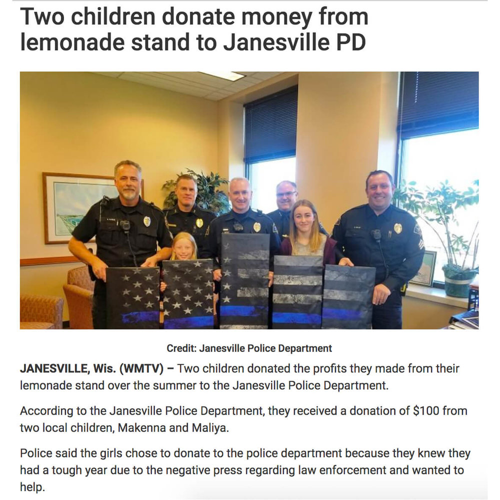 Lemonade stand and artwork for police department