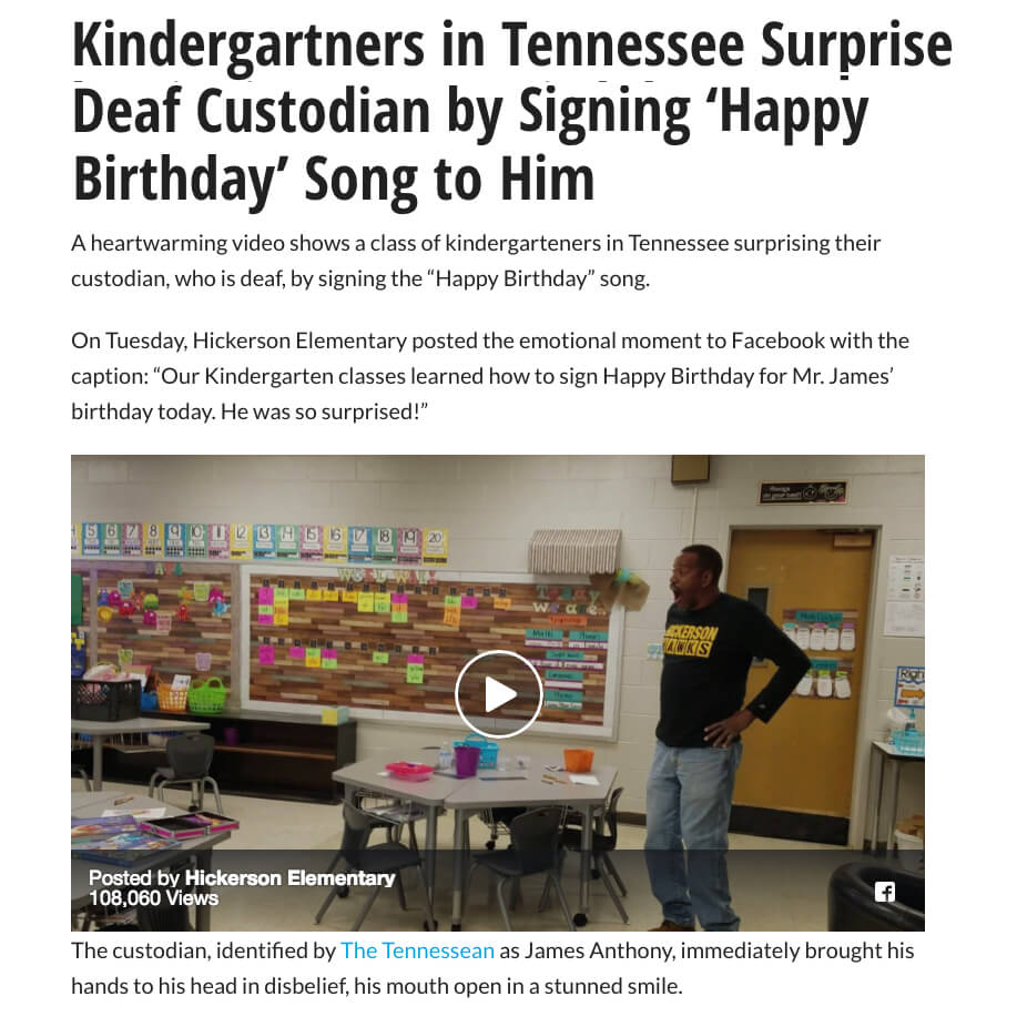 Kindergarten signs happy birthday to deaf custodian