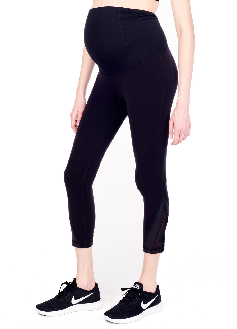 Active Mesh Detail Capri ft. Crossover Panel® - • Crossover Panel® offers gentle back support as your belly grows.•Crossover design keeps your back cool.•Wear panel over the belly or folded down.•Stays up! No more slipping or yanking.•Four-way stretch.•Moisture-wicking and antimicrobial.•Our best-selling active silhouette with mesh detail at calf.