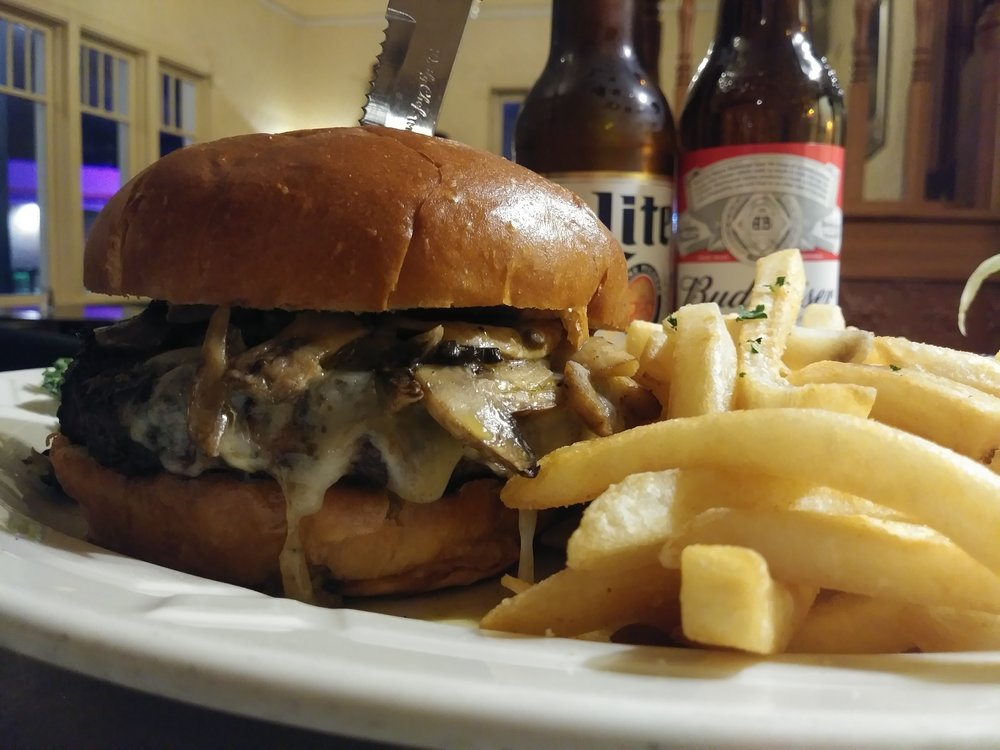 mushroom swiss burger - Our burger topped with fresh sautéed mushrooms and melted swiss cheese $11.99