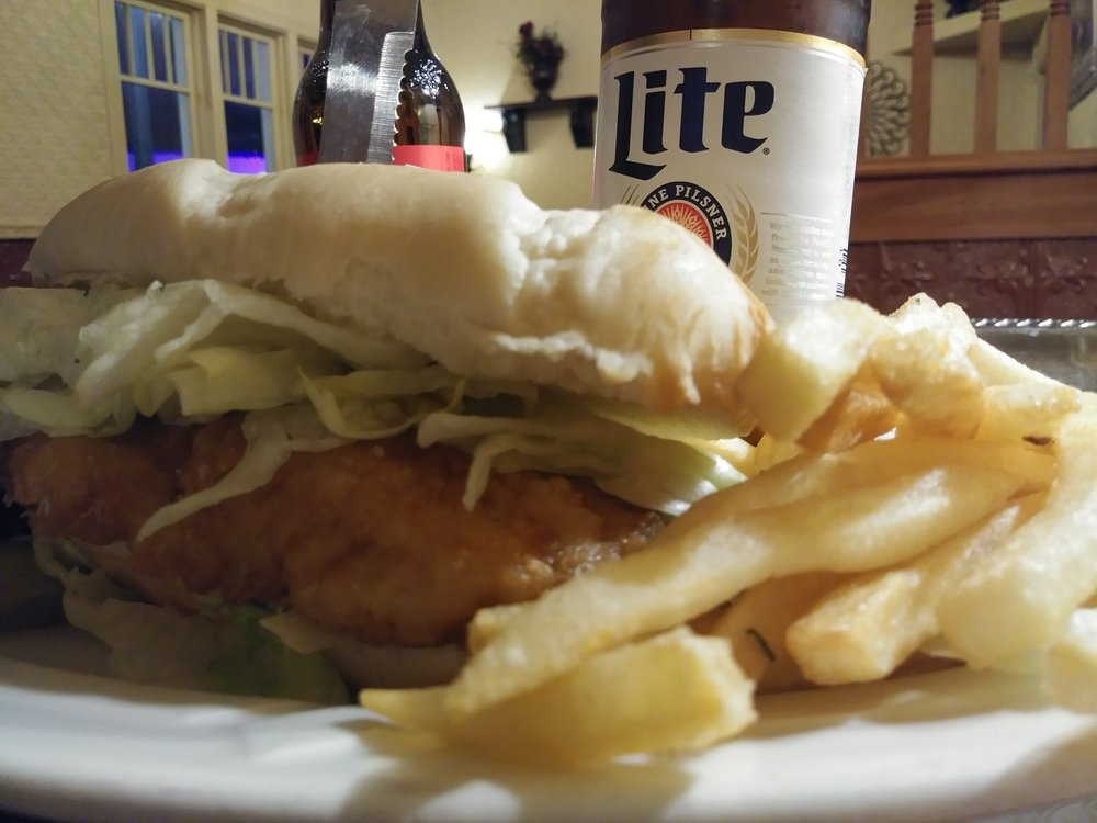 fish filet sandwich - A 6 ounce cod filet served on a hoagie bun with lettuce and our homemade tarter sauce $10.99