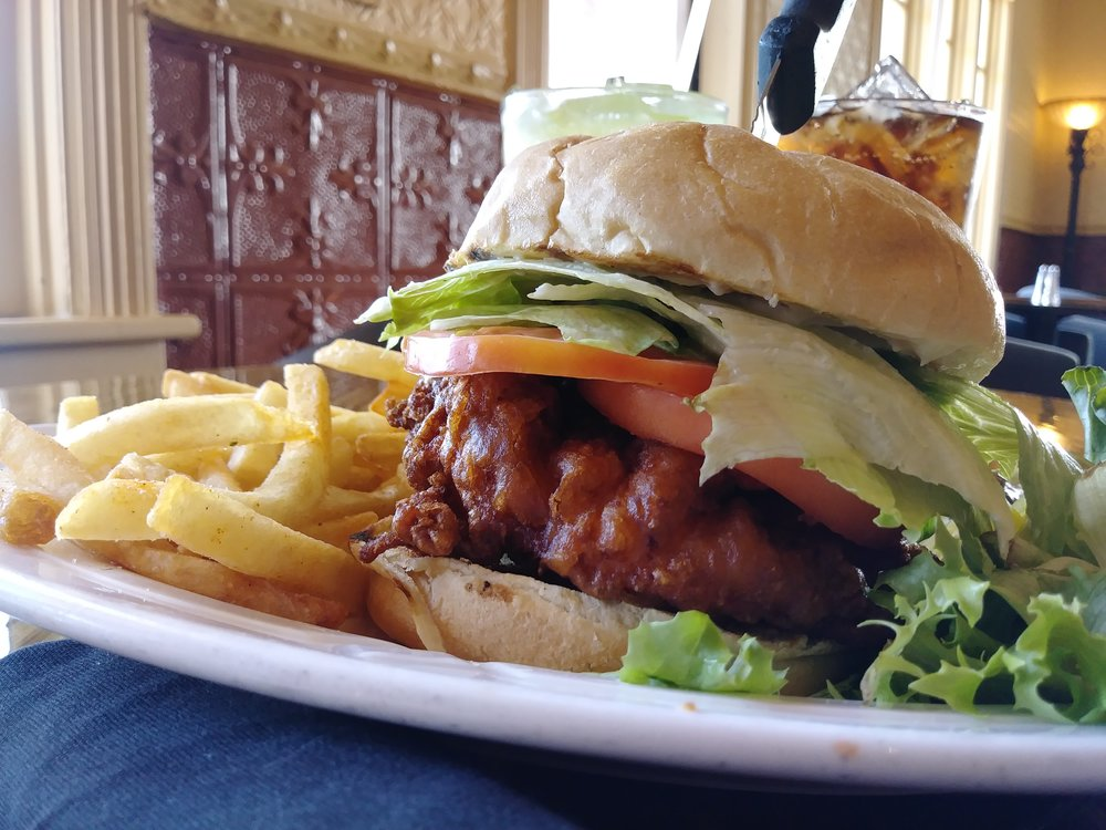 crispy chicken sandwich - 6 ounce hand battered chicken breast deep fried; topped with lettuce, tomato, mayo, & served on a Kaiser Roll $10.99