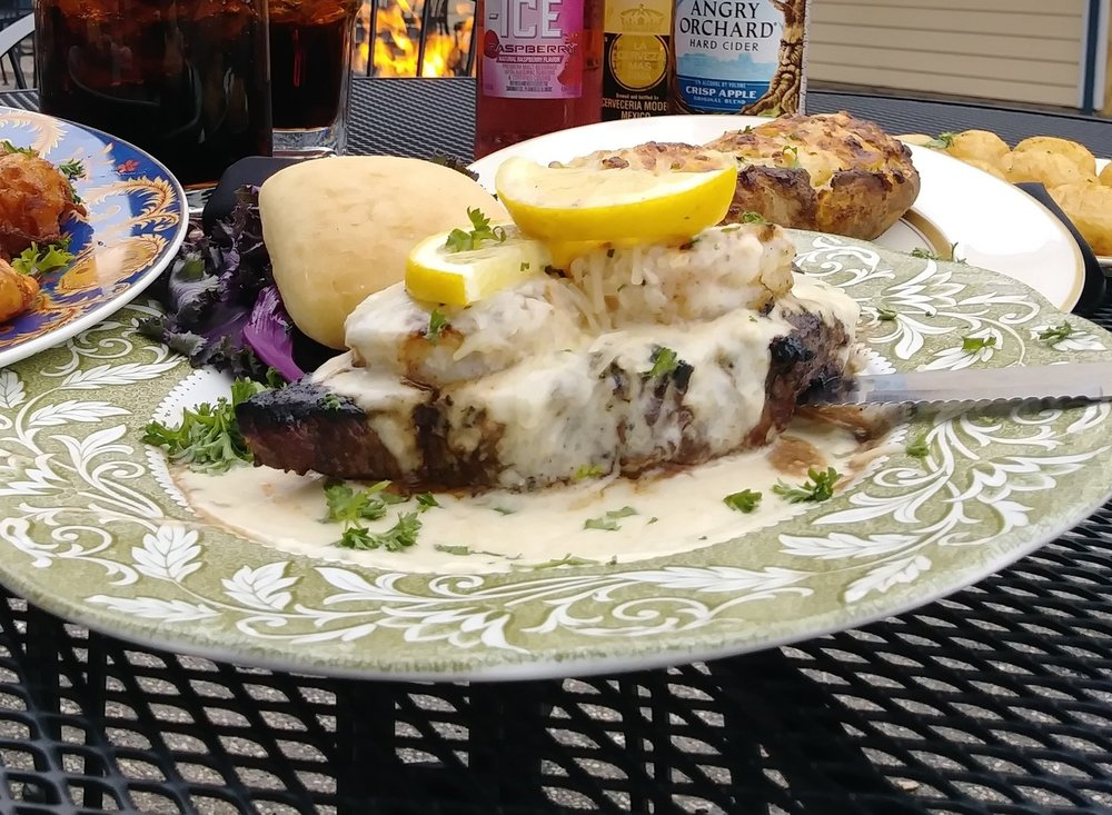 steak royale - Choice 8 ounce top sirloin, crowned with two jumbo shrimp and finished off with our own gourmet parmesan sauce $18.99