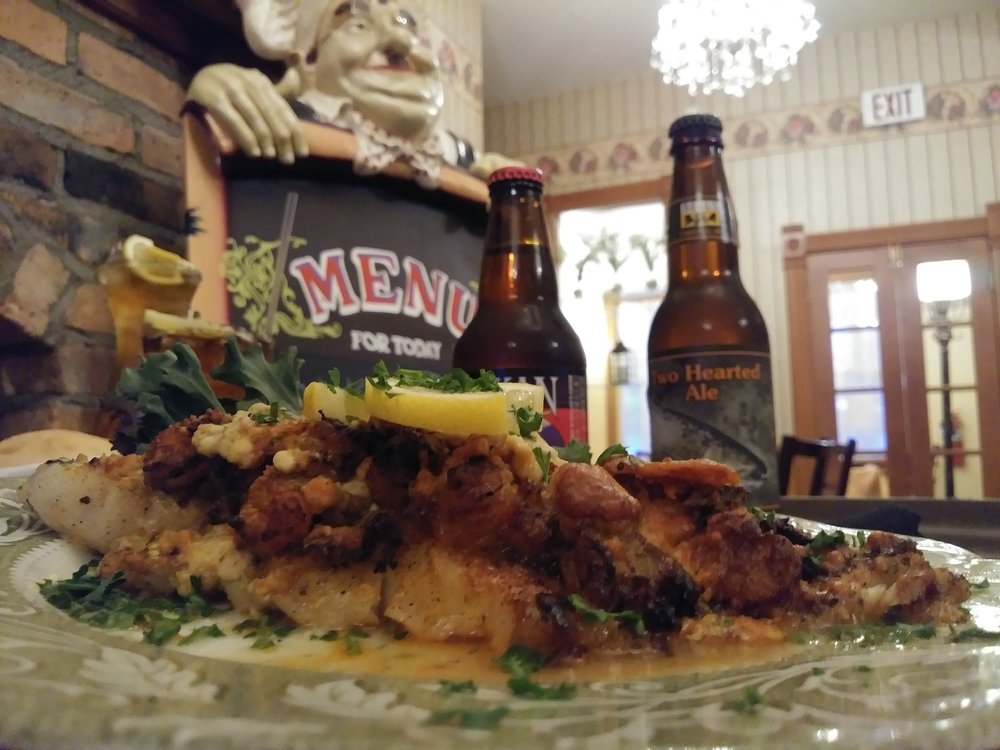 blue cheese Cajun catfish - A seasoned catfish filet crowned with sautéed Cajun catfish, then encrusted in seared blue cheese $17.99