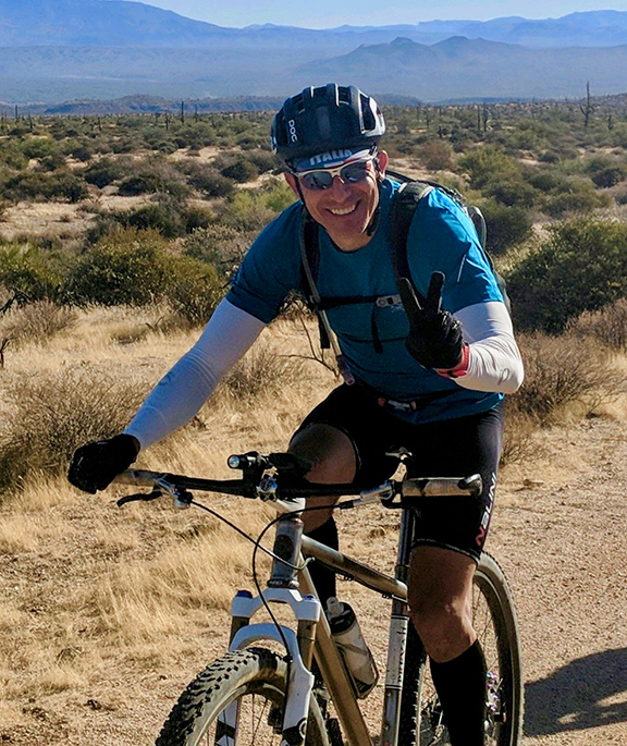 Beto Villegas - Beto maintains a degree in Psychology and is currently retired from a combined 26 years of public service. He committed most of his career to helping people achieve success in their personal endeavors, while focusing on fitness, nutrition and healthy relationships. He is also a former college and (international) professional baseball player spending many years training with strength and fitness coaches. Beto has also coached athletes from 13 to 60 years of age in basketball, baseball, softball, soccer, track and field, and cycling. Beto has been road racing and mountain-biking since 2002 and ultimately upgraded to a professional marathon racer in 2011. He also raced on the road competing in multi-day stage races and one-day events. Beto was trained by Dr. Michael Puchowicz to perform bike fits and has gained valuable knowledge on preventive sport injuries and rehab. He competes in cross-country, ultra-endurance mountain bike races, and bike-packs the 750+ miles of Arizona National Scenic Trail (AZT). His race highlights include six podium finishes at the 24 Hours of Old Pueblo, three podium finishes at the Epic Rides Whiskey Off-Road 50 Proof, podium at the El Paso Puzzler, 7th at Marathon Nationals, four podium finishes in Mexico, and numerous first place finishes in the Arizona and New Mexico Endurance Series. Beto is married to a most amazing wife, Shannon Villegas.