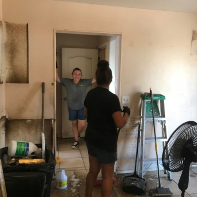 Work and laughter—Yesenia's House Cleaning scrubs away water damage, mold and dead insects.