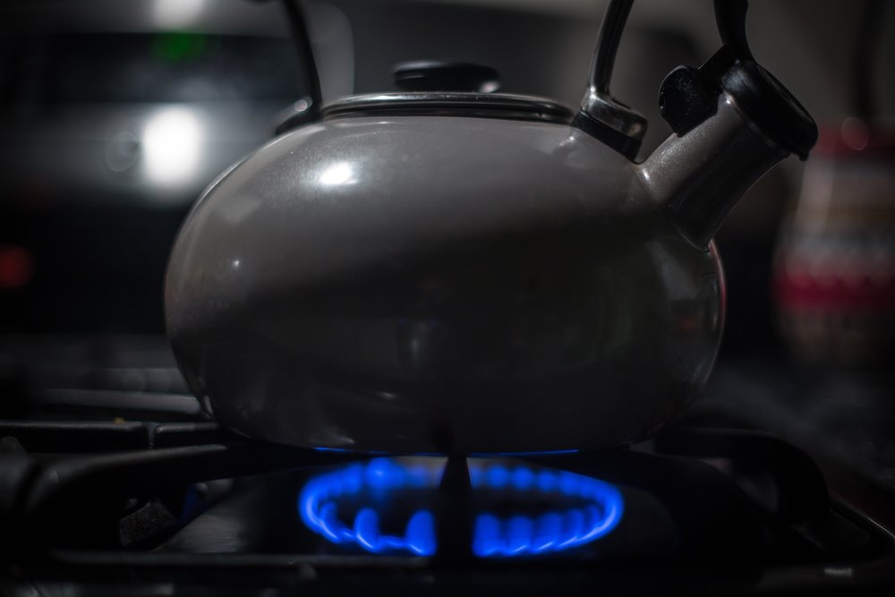 A few tea kettles of hot water are sometimes enough to soften and dislodge old soap and grease clogs. But, be careful!