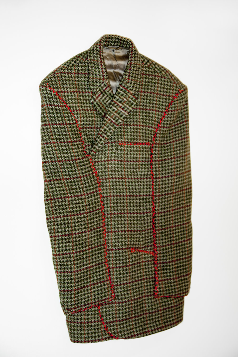 A Person Who Is Not A Cowboy,  2015, Houndstooth jacket, cotton thread 36 x 12 x 2.5