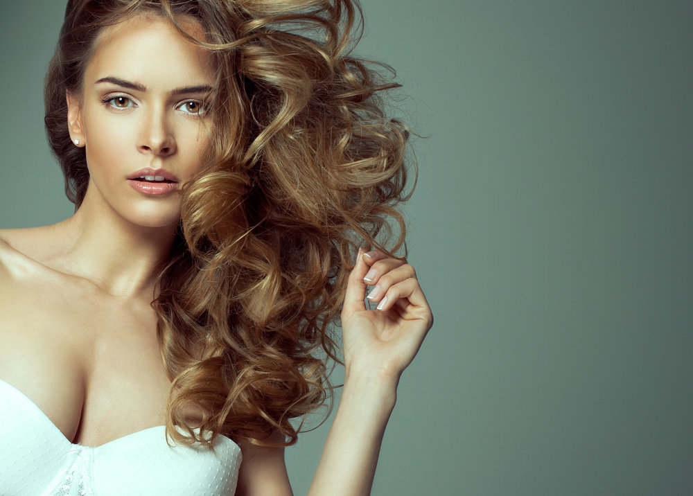 Purchase a Haircut + Blow Out &Receive a FREE Manicure -