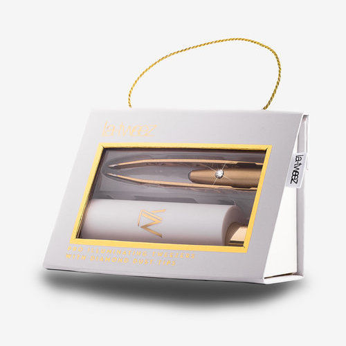 La Tweez Pro Illuminating Tweezers in White - Forget the bulky lighted mirror- plucking your brows to perfection has never been easier than with these illuminated tweezers by La Tweez. Crafted with fine stainless steel, the grip is flawless and the built-in light makes spotting every stray hair a breeze.