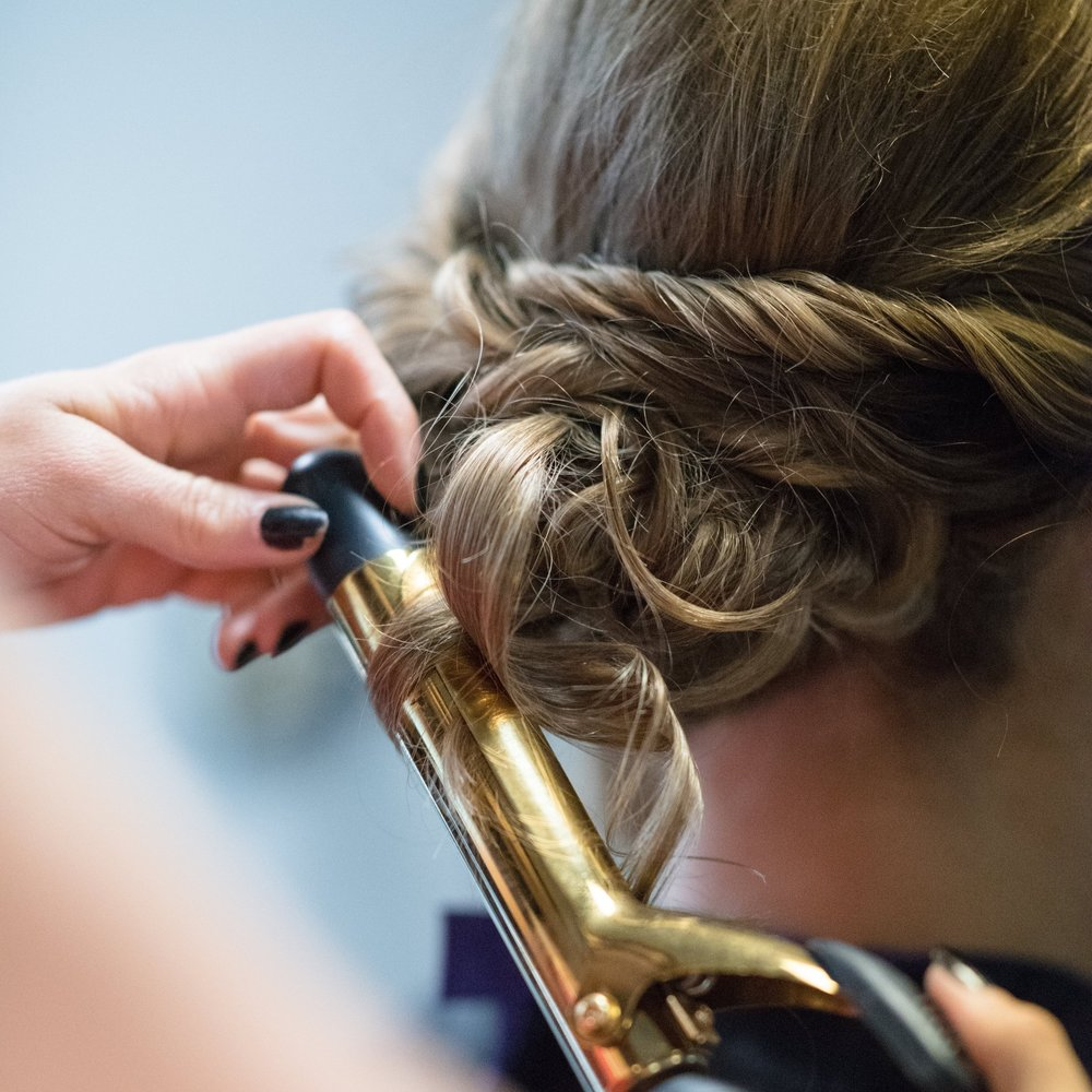 Curly Chic Chignon - This curly chignon looks sophisticated and over the top, but only takes a few minutes to master even if you aren't an Inscape Beauty Salon guru. Gather the length of your hair at the nape of your neck in a traditional chignon and then pull a few pieces out. Curl these pieces with a small barrel curling iron and your average chignon is instantly transformed into a lavish look.