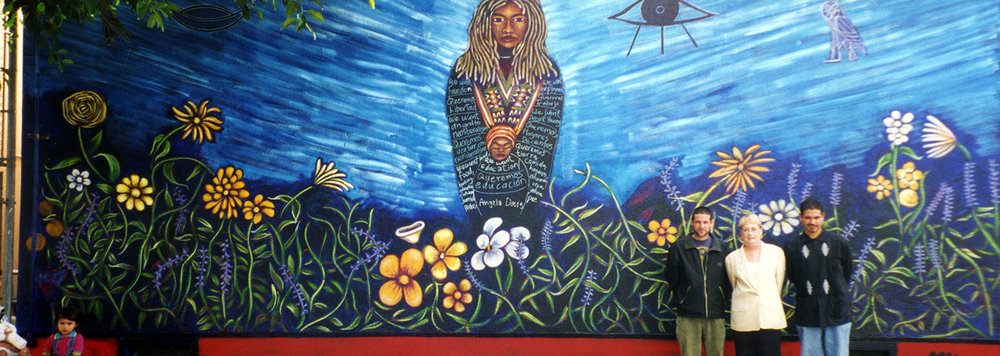 Angela Davis mural at Ascot Avenue Elementary, 1997.  My brother Omar and I painted two murals here.  The other is of Rigoberta Menchu.  Pictured is my principal, Ms. Fornaro.
