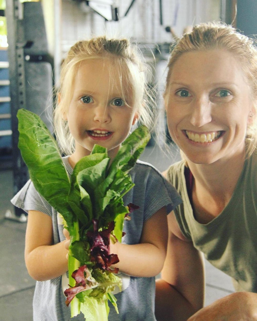 Mother and Daughter picking Fresh Organic Greens for lunch.