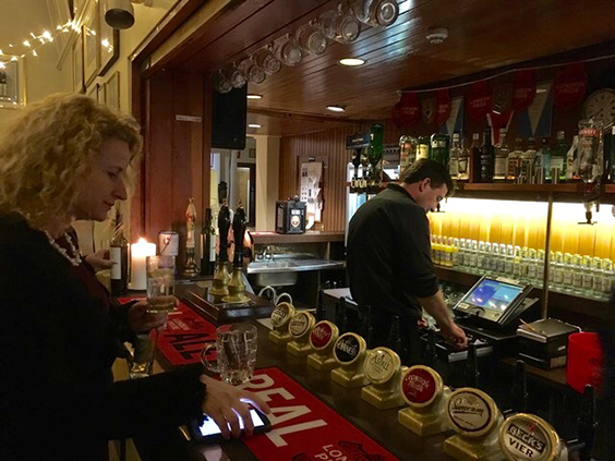 Tommy Kimmins, LRC barman, serves up pre-dinner drinks - Penny Bevan-Hopkins on the receiving end!