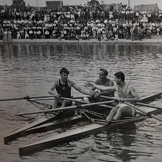 Rob in the boat after winning a bronze medal at the European Championships in 1955. Such gentlemanly behaviour as they congratulate each other after a hard race.