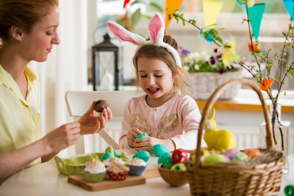 kid and parent decorating easter cakes