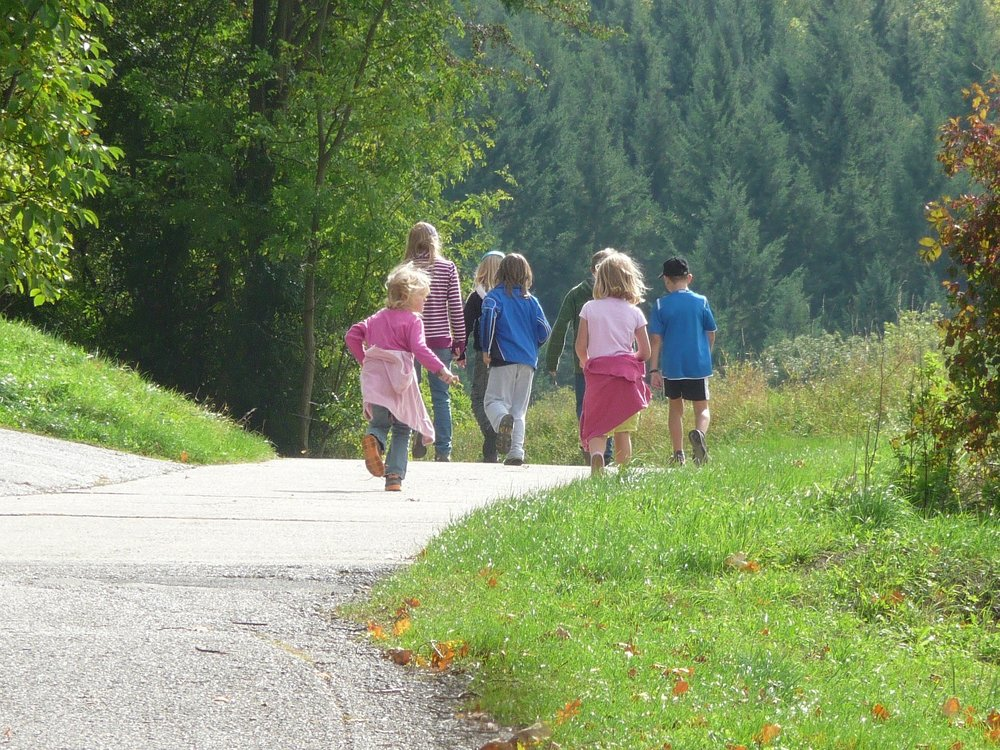 family walk with kids in the countryside