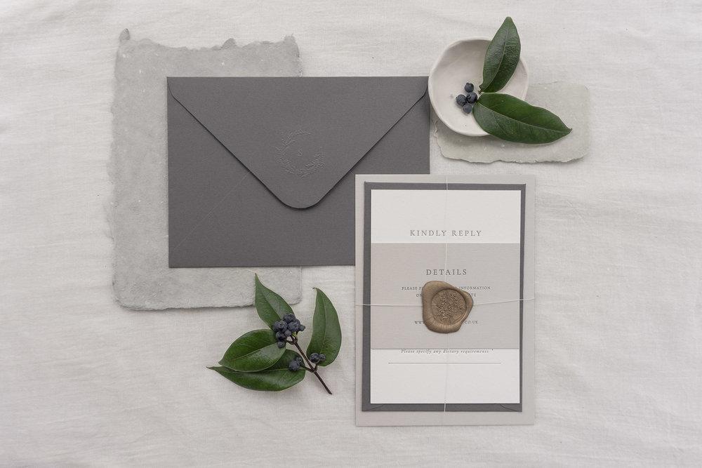bound invitation and envelope wreath monogram wax seal modern class letterpress.jpg