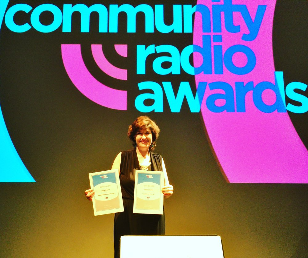 Louise-with-her-two-awards.jpg