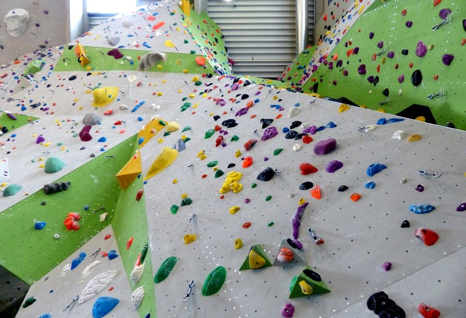A climbing wall with lots of coloured holds