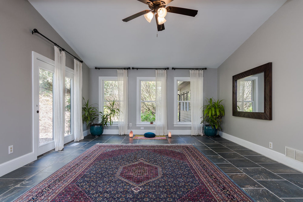 Photo of the indoor yoga studio at Bliss Farm and Retreat