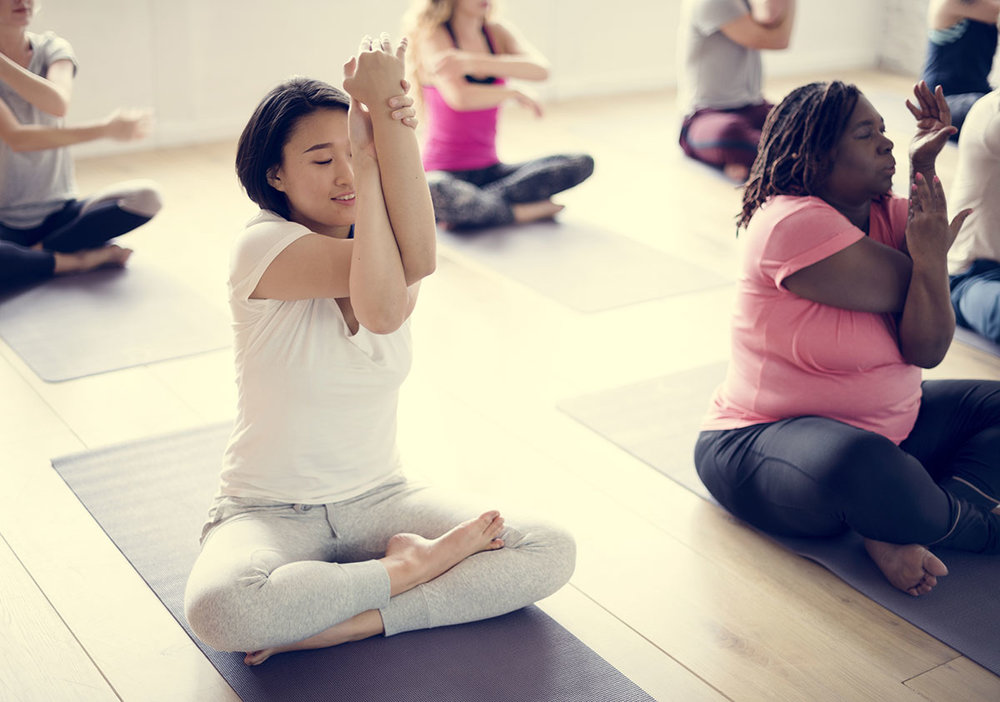 Diverse group of people participating in a Hatha Yoga class