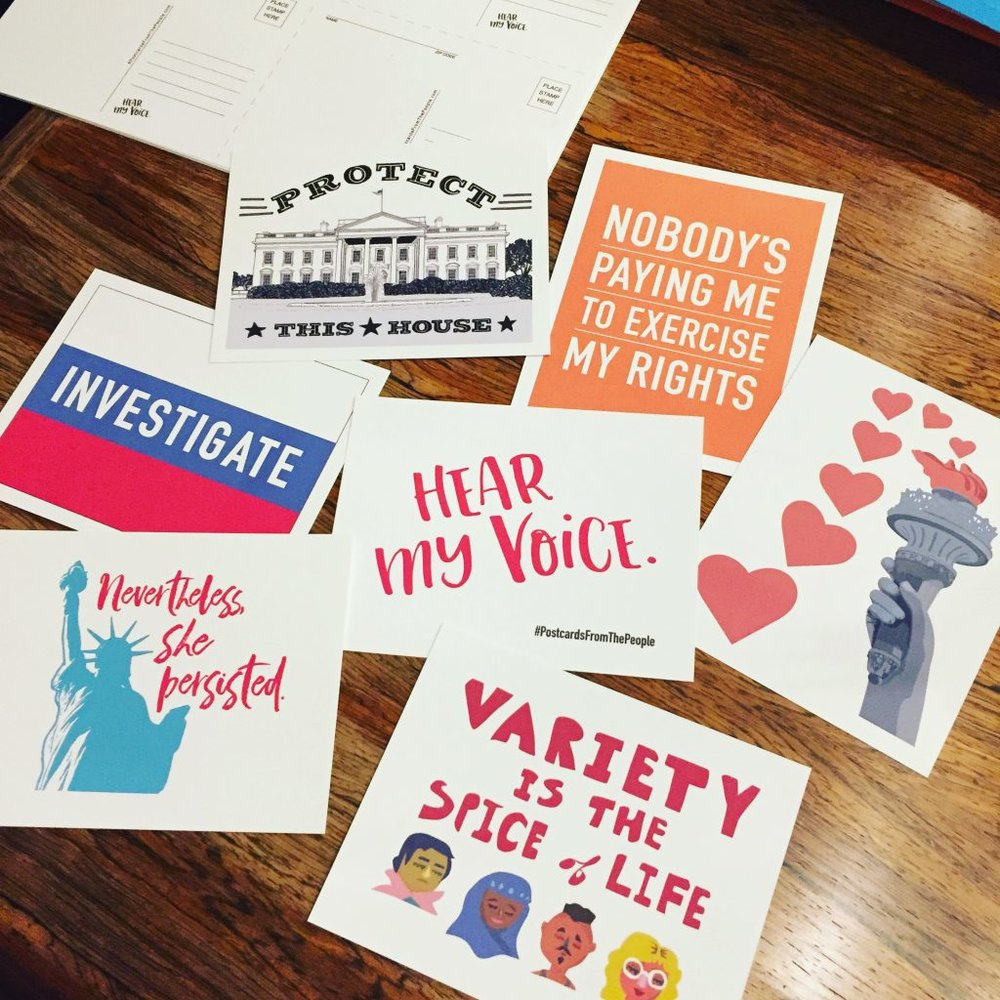 "Several Postcards From the People designs are displayed, including postcards that read, ""Investigate,"" ""Nevertheless, she persisted,"" ""Variety is the spice of life,"" and ""Nobody's paying me to exercise my rights."""