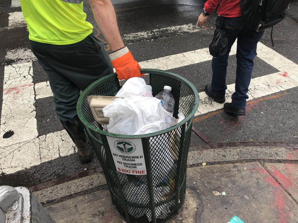 Sanitation Worker services a basket on 6th Avenue.  Photo by Van Alen Institute.