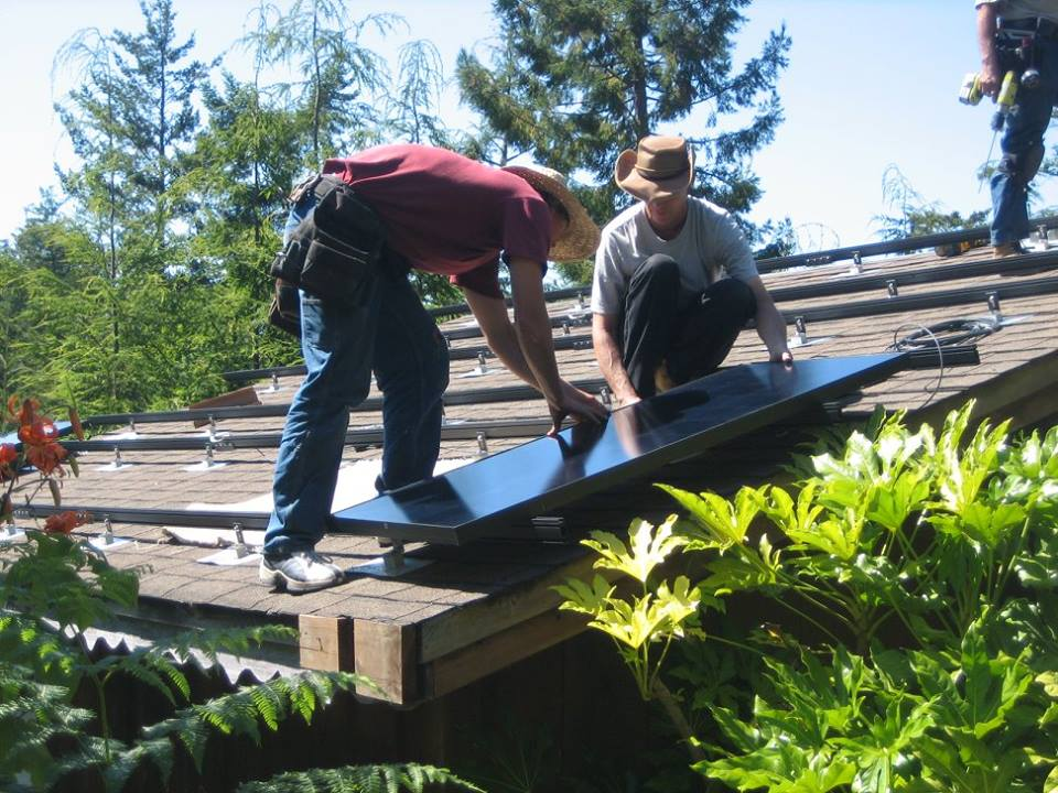 workers on roof installing solar.jpg