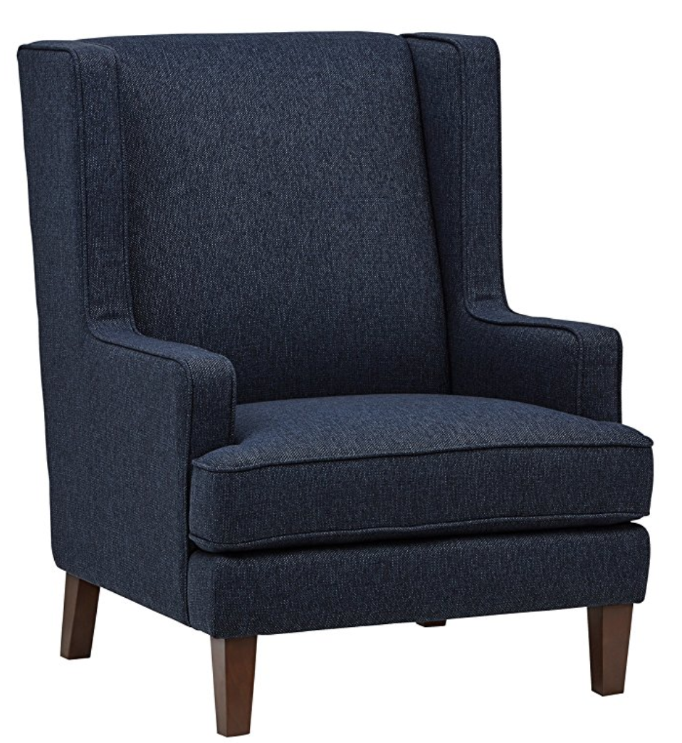 This  Wingback Accent Chair has a great texture and rich blue-- there's also two other colors available as well. These aren't bulky, but they've got enough of a shape to add some additional seating without feeling overwhelming. Rivet Abstract Wool Rug would go really well with these!