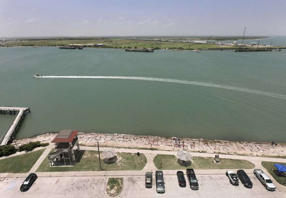 PHOTO: Billy Calzada/San Antonio Express-News  Looking across the channel from Port Aransas to Harbor Island, which may the the site of a proposed crude oil export terminal that would load the largest tankers in the world.