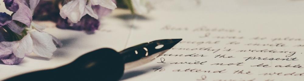 Photo by  Debby Hudson  on  Unsplash  Image description: Pen, flowers, and handwritten letter