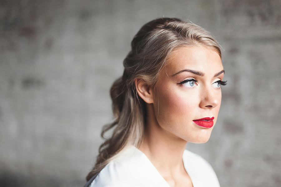 beautiful girl with wedding makeup and styled hair