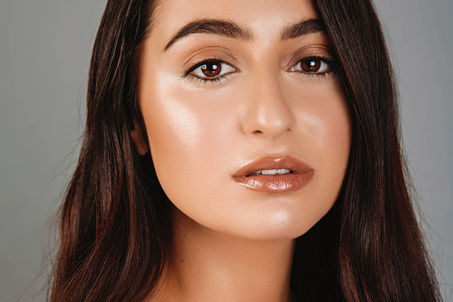 Beautiful girl with glowy skin and fresh makeup