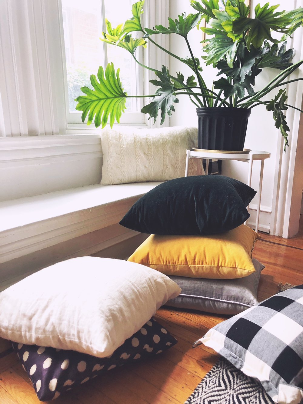 I'm always a sucker for throw pillows… - This is the easiest/cheapest way to add to color flavor into your home. Think about different materials - like velvets and linens — and some patterns to make it interesting. Polka dots and stripes will never go out of style.