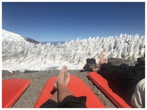 Getting a sun tan in front of the penitentes at 13,000'