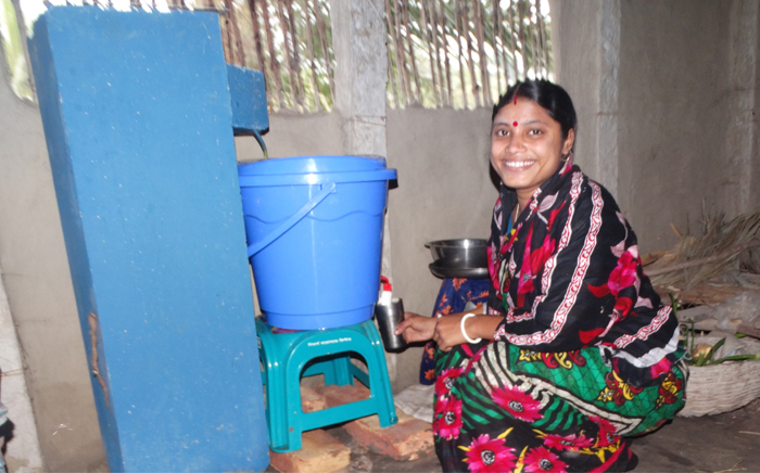 Suchitra Sarder grabs a glass of clean water in her home in the rural village of Porakatla, Bangladesh.